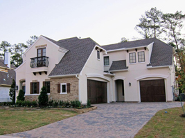 New Homes The Woodlands - Big home with a big brick driveway